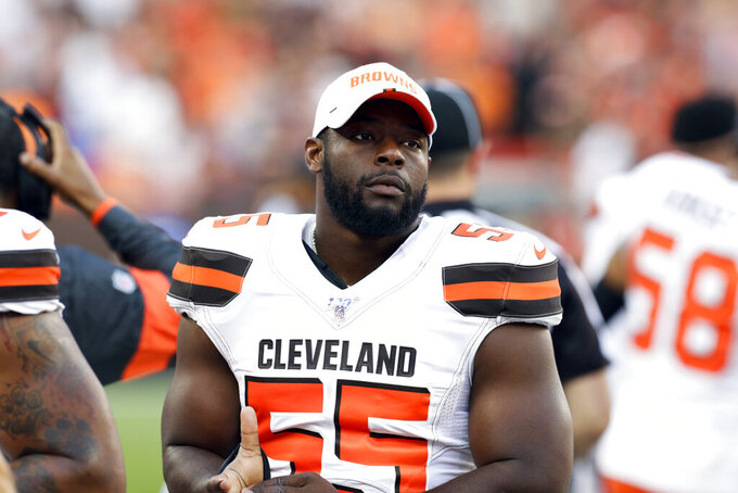 FILE - In this Aug. 8, 2019, file photo Cleveland Browns outside linebacker Genard Avery (55) stands on the sideline before an NFL preseason football game against the Washington Redskins in Cleveland.  The Browns have agreed to trade Avery to the Philadelphia Eagles for an undisclosed 2021 draft pick. (AP Photo/Ron Schwane, File)