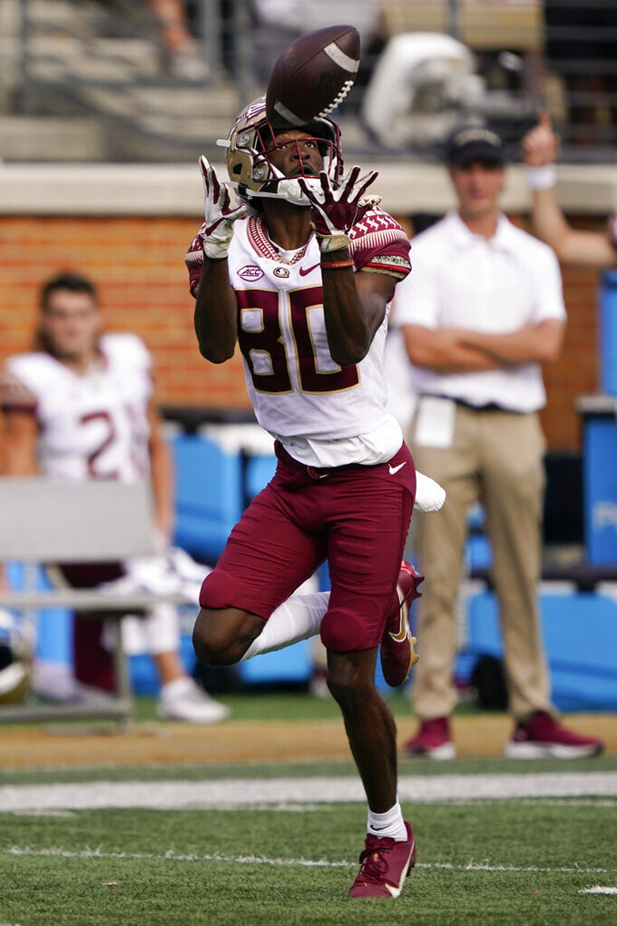 Florida State wide receiver Ontaria Wilson catches a touchdown pass against Wake Forest during the first half of an NCAA college football game Saturday, Sept. 18, 2021, in Winston-Salem, N.C. (AP Photo/Chris Carlson)