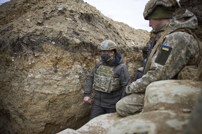 Ukrainian President Volodymyr Zelenskyy looks on as he visits the war-hit Donbas region, eastern Ukraine, Thursday, April 8, 2021. Ukraine's president is visiting the area of conflict in his country's east amid an escalation of tensions that has raised fears of a resumption of large-scale hostilities. (Ukrainian Presidential Press Office via AP)