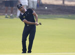Mexico's Abraham Ancer chips from the fringe of the 2nd green during the opening round of the Australian Open golf tournament in Sydney, Thursday, Dec. 5, 2019. (AP Photo/Rick Rycroft)