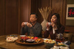 This image released by Netflix shows Tzi Ma, left, and and Christine Ko in a scene from