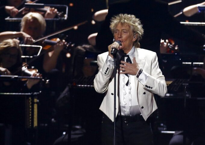 """FILE - In this Feb. 18, 2020 file photo, Rod Stewart performs on stage at the Brit Awards 2020 in London. A Florida judge on Thursday, Sept. 9, 2021, has canceled the trial for Stewart and his adult son and scheduled a hearing next month to discuss a plea deal to resolve misdemeanor charges. The singer of 70s hits such as """"Da Ya Think I'm Sexy?"""" and """"Maggie May"""" and his son are accused of pushing and shoving a security guard at an upscale hotel because he wouldn't let them into a New Year's Eve party nearly two years ago.  (Photo by Joel C Ryan/Invision/AP, File)"""