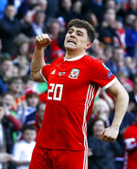 Wales' Daniel James celebrates scoring against Slovakia during the Euro 2020 qualifying, Group E soccer match at the Cardiff City Stadium, Wales, Sunday March 24, 2019. (Darren Staples/PA via AP)