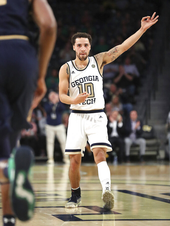 Georgia Tech guard Jose Alvarado plays air guitar after hitting a 3-pointer against Notre Dame during the first half of an NCAA college basketball game Wednesday, Jan. 15, 2020, in Atlanta. (Curtis Compton/Atlanta Journal-Constitution via AP)