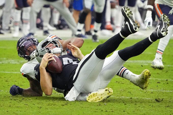 Chicago Bears linebacker Trevis Gipson (99) sacks Las Vegas Raiders quarterback Derek Carr (4) during the second half of an NFL football game, Sunday, Oct. 10, 2021, in Las Vegas. (AP Photo/Rick Scuteri)