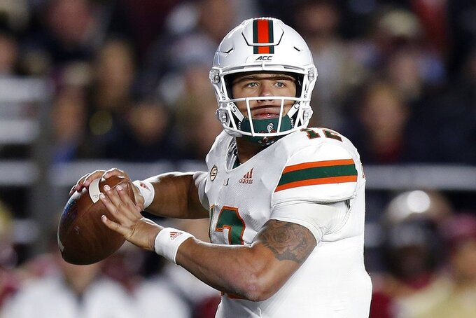 Miami quarterback Malik Rosier looks to pass during the first half of an NCAA college football game against Boston College in Boston, Friday, Oct. 26, 2018. (AP Photo/Michael Dwyer)