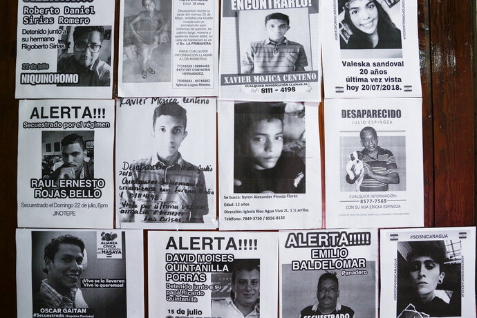 In this July 24, 2018 photo, flyers of missing persons cover a wall inside the Nicaraguan Center for Human Rights, in Managua, Nicaragua. The flyers represent part of at least 400 missing persons arrested in Nicaragua in nearly four months of unrest and subsequent crackdown, according to investigation by the center. (AP Photo/Arnulfo Franco)