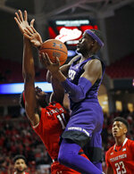TCU's Kouat Noi (12) shoots the ball over Texas Tech's Tariq Owens (11) during the first half of an NCAA college basketball game Monday, Jan. 28, 2019, in Lubbock, Texas. (AP Photo/Brad Tollefson)