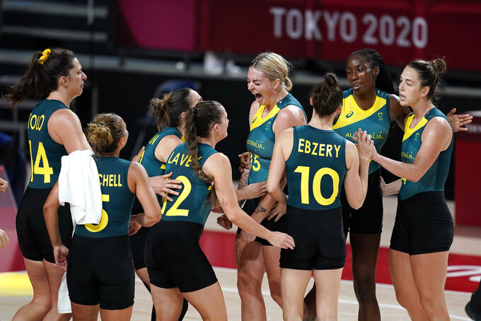 Australia players celebrate at the end of a women's basketball preliminary round game against Puerto Rico at the 2020 Summer Olympics, Monday, Aug. 2, 2021, in Saitama, Japan. (AP Photo/Charlie Neibergall)