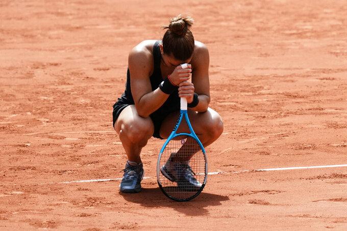 Maria Sakkari of Greece reacts as she defeats Poland's Iga Swiątek during their quarterfinal match of the French Open tennis tournament at the Roland Garros stadium Wednesday, June 9, 2021 in Paris. (AP Photo/Thibault Camus)