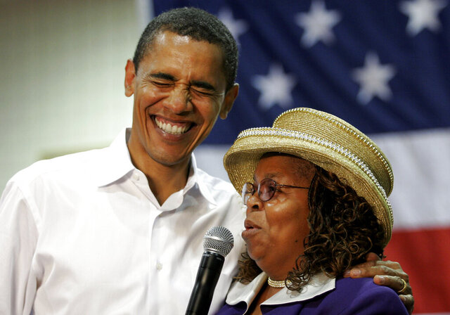 FILE - In this Oct. 6, 2007, file photo, then presidential hopeful Sen. Barack Obama, D-Ill., left, shares a laugh with Greenwood County, S.C., Council Woman, Edith Childs, right, whom he credited with giving him the idea for his popular
