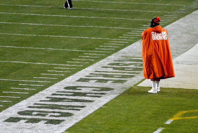 A Cleveland Browns player stands on the sideline during the second half of an NFL wild-card playoff football game against the Pittsburgh Steelers in Pittsburgh, Sunday, Jan. 10, 2021. (AP Photo/Don Wright)
