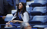 Meghan, Duchess of Sussex, waits for the start of the women's singles final of the U.S. Open tennis championships between Serena Williams, of the United States, and Bianca Andreescu, of Canada, Saturday, Sept. 7, 2019, in New York. (AP Photo/Adam Hunger)
