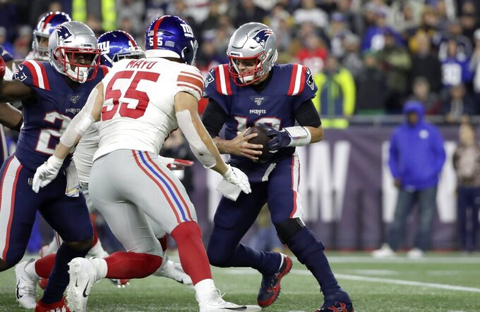 New York Giants outside linebacker David Mayo (55) closes in to sack New England Patriots quarterback Tom Brady, right, in the first half of an NFL football game, Thursday, Oct. 10, 2019, in Foxborough, Mass. (AP Photo/Elise Amendola)
