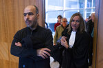 Dutch-Palestinian man Ismail Zeyada, originally from the Gaza Strip, left, and his lawyer Liesbeth Zegveld, enter The Hague District Court, Netherlands, Wednesday, Jan. 29, 2020. The Dutch court is expected to rule on a case b brought by Zeyada on whether it has jurisdiction to take on a case in which he is seeking to sue Benny Gantz, former Chief of Staff of the Israel Defense Forces, and another Israeli military commander over their roles in an air strike that killed six members of his family. (AP Photo/Peter Dejong)