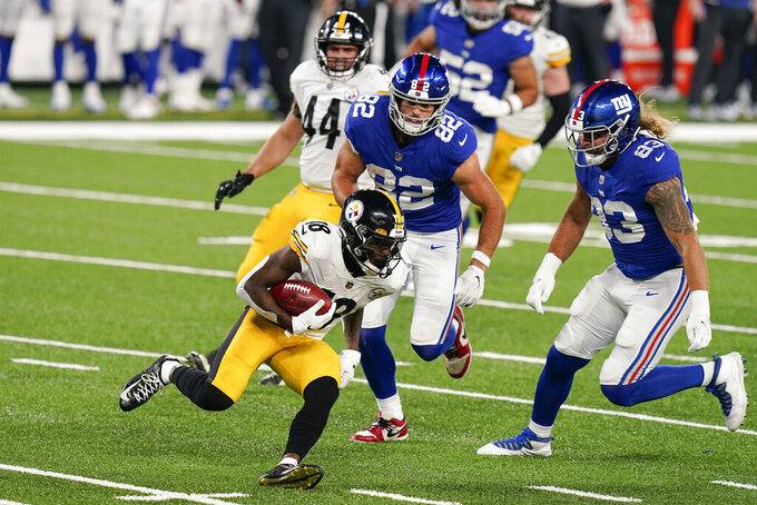 Pittsburgh Steelers wide receiver Diontae Johnson (18) runs the ball against New York Giants tight end Kaden Smith (82) and tight end Eric Tomlinson (83) during the second quarter of an NFL football game Monday, Sept. 14, 2020, in East Rutherford, N.J. (AP Photo/Seth Wenig)