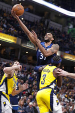 Minnesota Timberwolves forward Keita Bates-Diop (31) shoots over Indiana Pacers guard Aaron Holiday (3) during the first half of an NBA basketball game in Indianapolis, Friday, Jan. 17, 2020. (AP Photo/Michael Conroy)