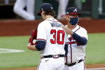 Atlanta Braves manager Brian Snitker, right, removes starting pitcher Kyle Wright (30) from] during the first inning against the Los Angeles Dodgers during the first inning in Game 3 of a baseball National League Championship Series Wednesday, Oct. 14, 2020, in Arlington, Texas.  (Curtis Compton/Atlanta Journal-Constitution via AP)