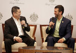 Donald Trump Jr., right, son of U.S. President Donald Trump, shares a light moment with Media Nusantara Citra (MNC) Group President and CEO Hary Tanoesoedibjo during a press conference in Jakarta, Indonesia, Tuesday, Aug. 13, 2019. U.S. President Trump's son and his Indonesian business partner say a theme park that also features a Trump hotel and condos will no longer have Chinese financing. (AP Photo/Fadlan Syam)