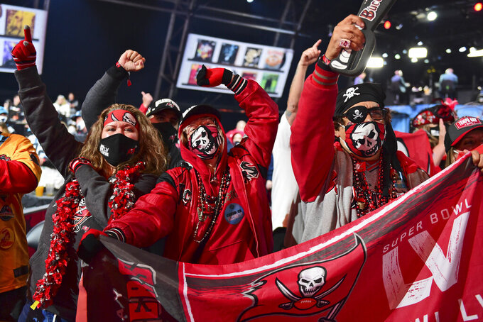 Tampa Bay Buccaneers fans cheer after Tampa Bay picked Kyle Trask, from Florida, in the second round of the NFL football draft Friday, April 30, 2021, in Cleveland. (AP Photo/David Dermer)