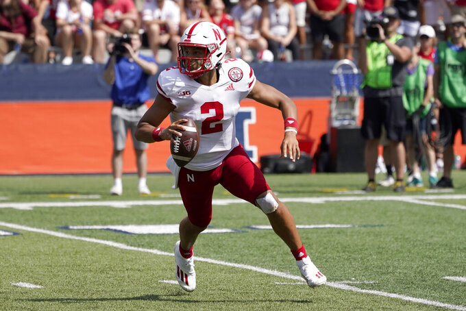 Nebraska quarterback Adrian Martinez scrambles during the second half of an NCAA college football game against Illinois Saturday, Aug. 28, 2021, in Champaign, Ill. Illinois won 30-22. (AP Photo/Charles Rex Arbogast)