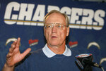 "FILE - San Diego Chargers head coach Marty Schottenheimer answers a question at a news conference in San Diego, in this Wednesday, Jan. 17, 2007, file photo. Marty Schottenheimer, who won 200 regular-season games with four NFL teams thanks to his ""Martyball"" brand of smash-mouth football but regularly fell short in the playoffs, has died. He was 77. Schottenheimer died Monday night, Feb. 8, 2021,  at a hospice in Charlotte, North Carolina, his family said through Bob Moore, former Kansas City Chiefs publicist. (AP Photo/Denis Poroy, File)"