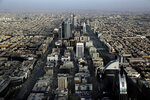 FILE - This June 23, 2018, file photo, shows a general view of Riyadh, Saudi Arabia. Another Saudi woman has turned to social media for protection from her father just days after Canada granted refuge to Rahaf al-Qunun, the 18-year-old Saudi who fled the country to escape her family. This latest plea comes from inside Saudi Arabia. The attempted escapes challenge a system that grants men guardianship of women who must obey fathers, husbands and brothers. (AP Photo/Nariman El-Mofty, File)