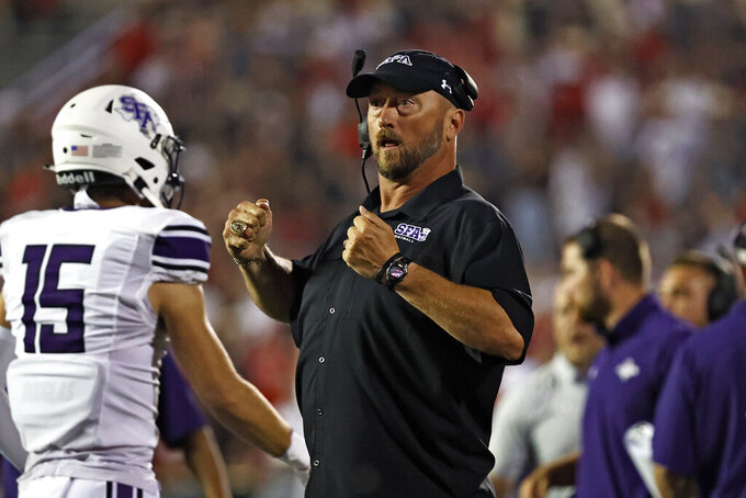 Stephen F. Austin coach Colby Carthel yells after a touchdown during the second half of the team's NCAA college football game against Texas Tech, Saturday, Sept. 11, 2021, in Lubbock, Texas. (AP Photo/Brad Tollefson)