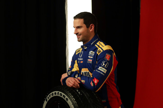 IndyCar driver Alexander Rossi poses for photos during IndyCar Media Day, Monday, Feb. 10, 2020, in Austin, Texas. (AP Photo/Eric Gay)