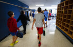 Students walk through the halls of Salisbury Middle School Tuesday, September 25, 2019 in Salisbury Township. In the area school districts vary from wealthy to poor. While some school district have the newest tech, other districts are not so fortunate. (Rick Kintzel/The Morning Call via AP)