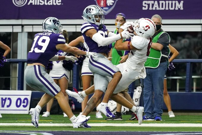 Stanford safeties Caleb Ellis (19) and Omari Porter, center, defend as Stanford wide receiver Brycen Tremayne (81) catches a touchdown pass in the second half of an NCAA college football game in Arlington, Texas, Saturday, Sept. 4, 2021. (AP Photo/Tony Gutierrez)