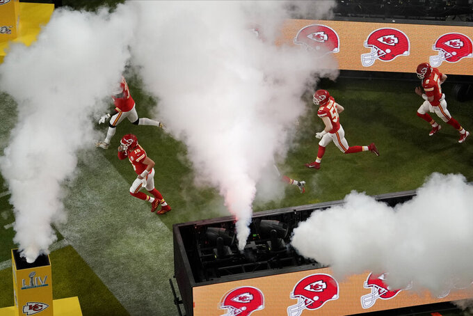 The Kansas City Chiefs' enter the field, before the NFL Super Bowl 54 football game between the San Francisco 49ers and Kansas City Chiefs, Sunday, Feb. 2, 2020, in Miami Gardens, Fla. (AP Photo/Morry Gash)