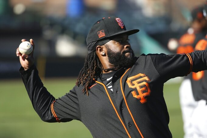 San Francisco Giants pitcher Johnny Cueto warms up during spring training baseball workouts for pitchers and catchers Wednesday, Feb. 12, 2020, in Scottsdale, Ariz. (AP Photo/Ross D. Franklin)