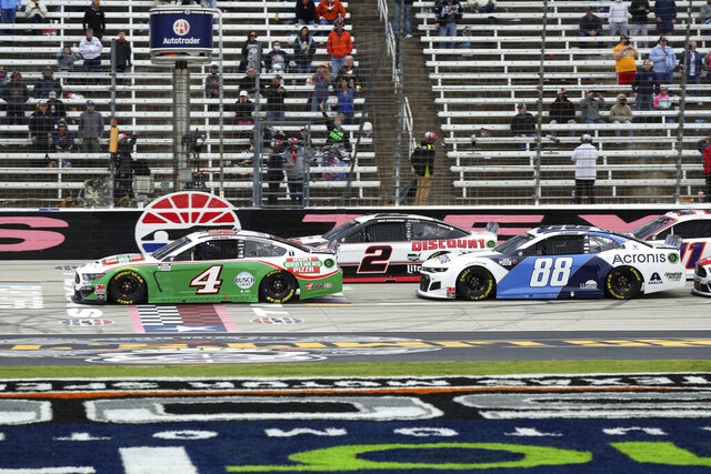 Kevin Harvick (4), Brad Keselowski (2) and Alex Bowman (88) cross the starting line to begin a NASCAR Cup Series auto race at Texas Motor Speedway in Fort Worth, Texas, Sunday, Oct. 25, 2020. (AP Photo/Richard W. Rodriguez)