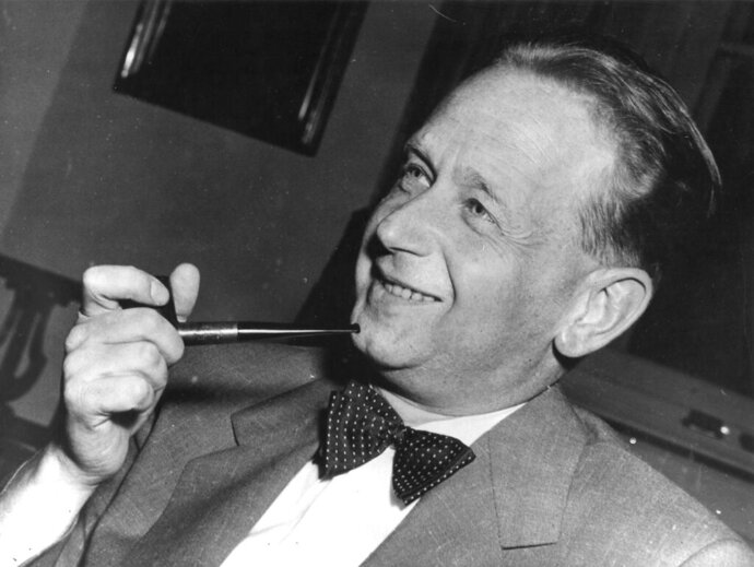 FILE - In this May 19, 1953, file photo, Dag Hammarskjold, recently appointed secretary general of the United Nations who is on a visit to Sweden, smokes his pipe at a news conference at the Foreign Office in Stockholm. In a report released Monday, Oct. 7, 2019, the head of the latest investigation into the mysterious 1961 plane crash that killed Hammarskjold says an external attack may have downed the aircraft and is urging the U.S., Britain, South Africa and Russia to provide more information. (AP Photo/File)