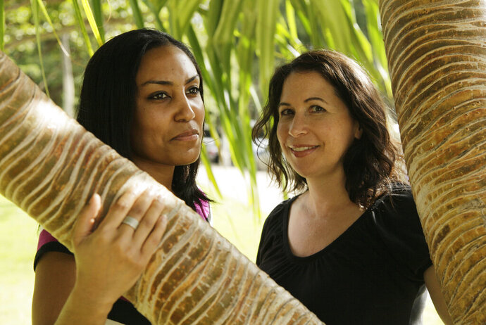 FILE - In this Dec. 19, 2011 file photo, Taeko Bufford, left, and Diane Cervelli, right, pose for a photo in Honolulu. The U.S. Supreme Court is rejecting an appeal from a Hawaii bed and breakfast that wouldn't rent a room to the lesbian couple. The justices on Monday, March 18, 2019 left in place Hawaii state court rulings that found the Aloha Bed & Breakfast in Honolulu violated Hawaii's anti-discrimination law by turning the couple away. Owner Phyllis Young had argued she should be allowed to turn away gay couples because of her religious beliefs. (AP Photo/Eric Risberg, File)