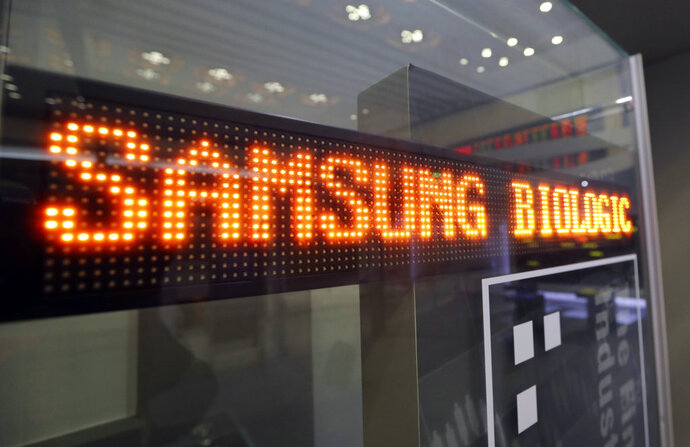 FILE - In this Nov. 10, 2016, file photo, a name of Samsung Biologics Co. is displayed at the Korea Exchange in Seoul, South Korea. A South Korean regulator says Samsung Biologics has intentionally breached accounting rules. The Financial Services Commission said Thursday, July 13, 2018, that it will bring the case to prosecutors and ask Samsung Biologics to dismiss executives in charge of accounting breaches.(AP Photo/Lee Jin-man, File)