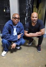 """This image released by David Jassy shows Jassy, a Swedish music producer, left, and rapper Common at San Quentin State Prison in California. Jassy, whose sentence was commuted by California Gov. Gavin Newsom this year, produced an album """"San Quentin Mixtape, Vol. 1,"""