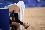 Jacob Gibb (1), of the United States, sits on the bench after losing to Germany in a men's beach volleyball match at the 2020 Summer Olympics, Monday, Aug. 2, 2021, in Tokyo, Japan. (AP Photo/Felipe Dana)