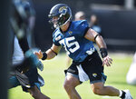 Jacksonville Jaguars tight end Tim Tebow runs a drill during NFL football training camp, Wednesday, July 28, 2021, at the team's practice fields outside TIAA Bank Field in Jacksonville, Fla. (Bob Self/The Florida Times-Union via AP)