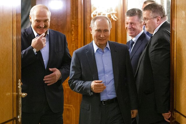 FILE - In this file photo taken on Friday, Feb. 7, 2020, Russian President Vladimir Putin, center, and Belarusian President Alexander Lukashenko enter a hall for talks in Rosa Khutor, in the Black Sea resort of Sochi, Russia. Lukashenko said Friday Feb. 21, 2020, he discussed during a phone call with Putin, about their continuing oil price dispute, but failed to reach an agreement that would ensure steady supplies of oil flow from Russia to its neighboring ex-Soviet state. (AP Photo/Alexander Zemlianichenko, Pool, File)