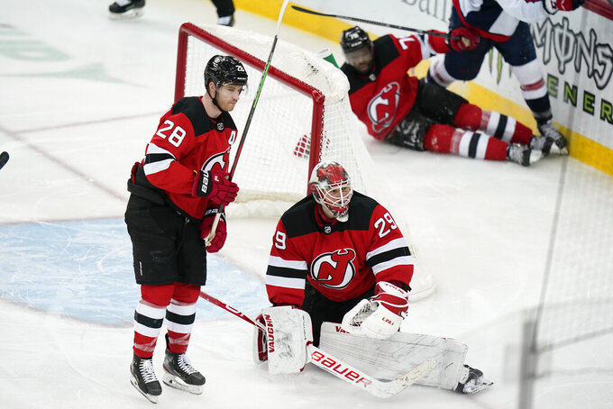 New Jersey Devils goaltender Mackenzie Blackwood (29) and teammates Damon Severson (28) and P.K. Subban react after Washington Capitals' Carl Hagelin scored a goal during the third period of an NHL hockey game Sunday, April 4, 2021, in Newark, N.J. The Capitals won 5-4. (AP Photo/Frank Franklin II)