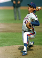 FILE - In this April 5, 1983 file photo, New York Mets pitcher Tom Seaver throws against the Philadelphia Phillies at Shea Stadium in New York. Seaver has been diagnosed with dementia and has retired from public life. The family of the 74-year-old made the announcement Thursday, March 7, 2019, through the Hall and said Seaver will continue to work in the vineyard at his home in California. (AP Photo/Richard Drew, File)
