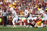Bowling Green quarterback Matt McDonald (3) runs with the ball after avoiding a tackle by Minnesota defensive lineman DeAngelo Carter (99) during the second half of an NCAA college football game Saturday, Sept. 25, 2021, in Minneapolis. Bowling Green won 14-10. (AP Photo/Stacy Bengs)