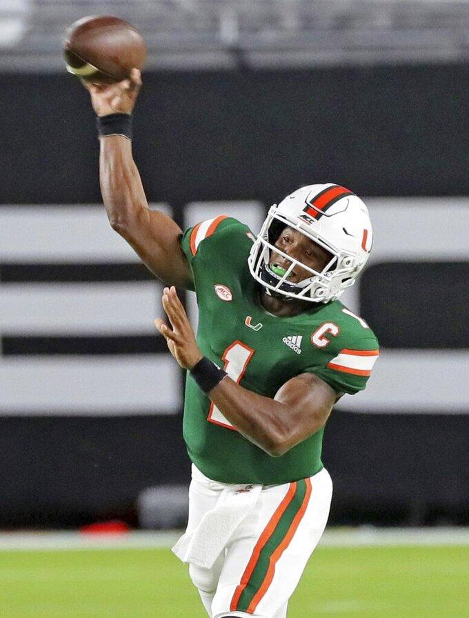 Miami quarterback D'Eriq King throws in the first quarter of an NCAA college football game against Florida State, Saturday, Sept. 26, 2020, in Miami Gardens, Fla. (Al Diaz/Miami Herald via AP)