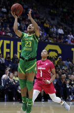 Oregon's Minyon Moore, left, shoots past California's Leilani McIntosh (1) in the first half of an NCAA college basketball game Friday, Feb. 21, 2020, in Berkeley, Calif. (AP Photo/Ben Margot)