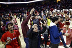 Students and fans storm the court after Temple won an NCAA college basketball game against Houston, 73-69, Wednesday, Jan. 9, 2019, in Philadelphia. (AP Photo/Matt Slocum)