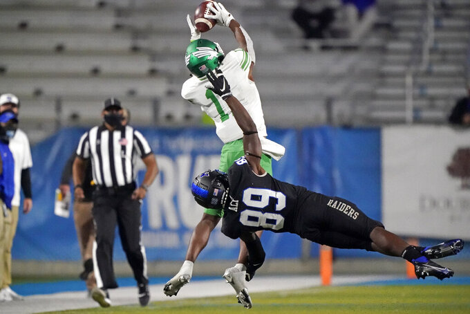 North Texas defensive back Cam Johnson (11) intercepts a pass intended for Middle Tennessee wide receiver Yusuf Ali (89) in the second half of an NCAA college football game Saturday, Oct. 17, 2020, in Murfreesboro, Tenn. (AP Photo/Mark Humphrey)