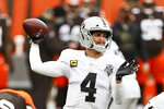 Las Vegas Raiders quarterback Derek Carr throws during the first quarter of an NFL football game against the Cleveland Browns, Sunday, Nov. 1, 2020, in Cleveland. (AP Photo/Ron Schwane)