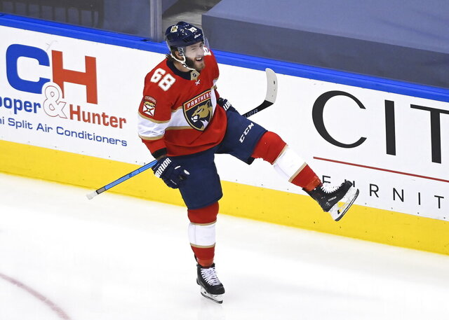 FILE - In this Wednesday, Aug. 5, 2020, file photo, Florida Panthers left wing Mike Hoffman celebrates his goal against the New York Islanders during the third period of an NHL Eastern Conference Stanley Cup playoff hockey game, in Toronto. The St. Louis Blues signed Hoffman, one of the top free agents left on the market, to a professional tryout agreement for training camp, in a move announced Sunday, Dec. 27, 2020. (Nathan Denette/The Canadian Press via AP, File)